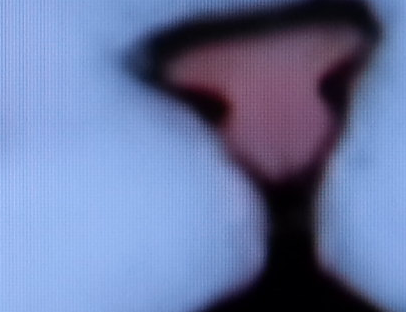 Image of a cat's nose with pixels all over the place - clearly photographing a TV screen.
