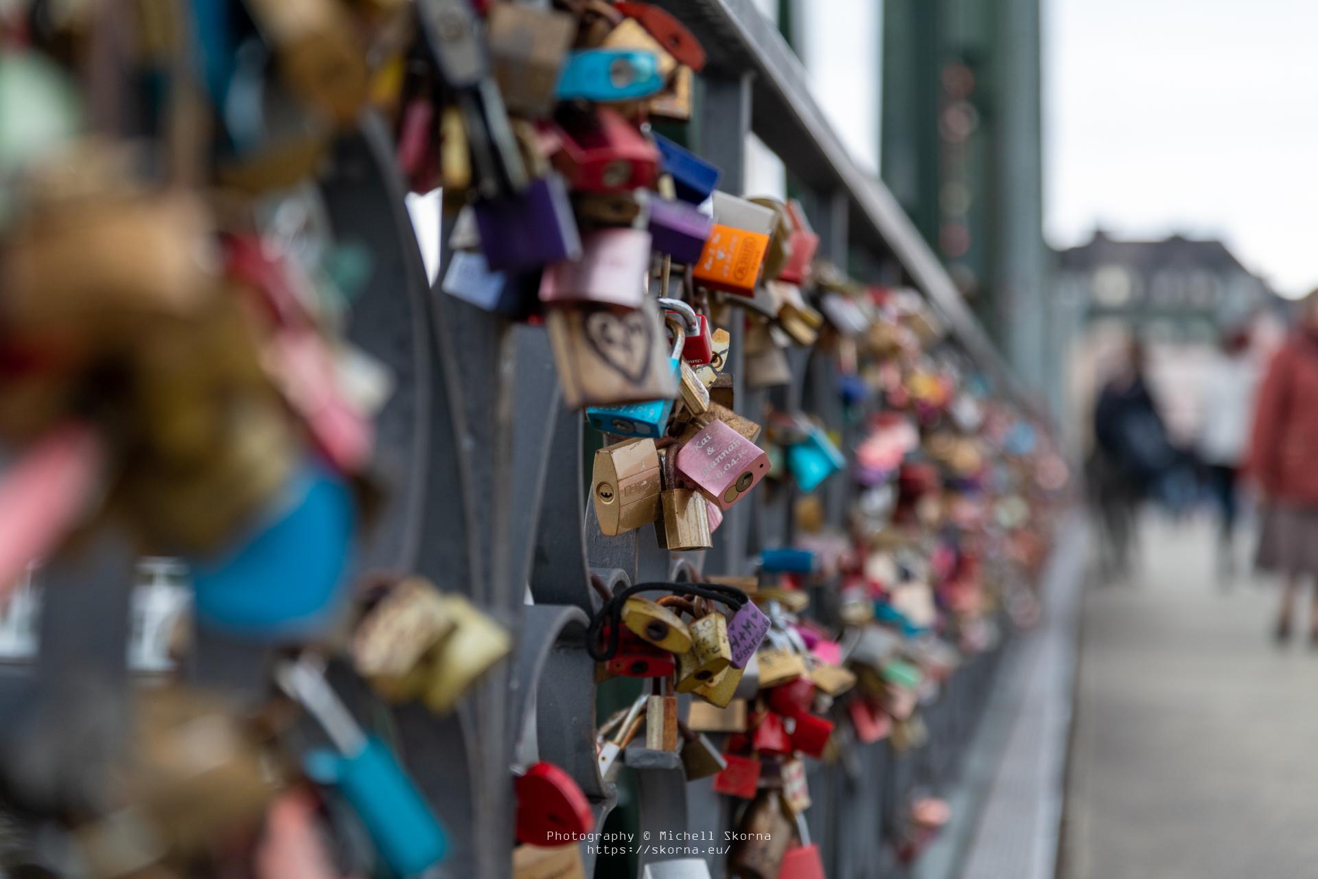 """Various Locks at the """"Love Lock Bridge"""" (Eiserner Steg) in Frankfurt am Main, Germany."""